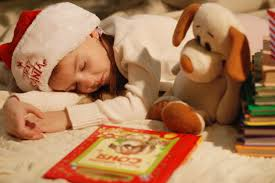 sleeping child with book